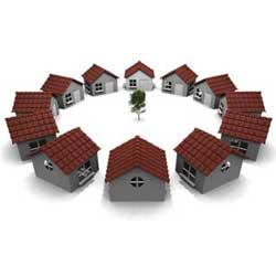 La imagen muestra un grupo de casas del cículo en relación con la cooperativa de vivienda