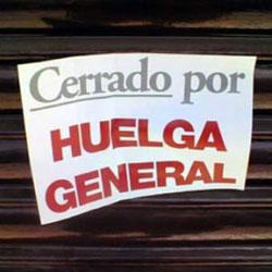 """La imagen muestra un cartel donde porne escrito """"cerrado por huelga general"""""""