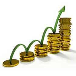 La imagen muestra unas monedas que forman una escalera y una flecha subiendo sobre ellas en referencia a la posición del IPC del 3% en 2010