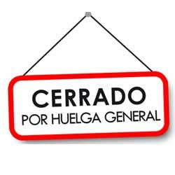 """Imagen en la que aparece un letrero que dice """"cerrado por huelga general"""""""