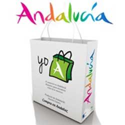 Imagen de una bolsa de compras con el logotipo de Andalucía haciendo referencia a la nueva ley de comercio interior de Andalucía. Encima de ella aparece otra vez el logotipo de Andalucía