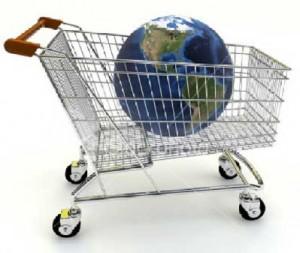 Carro de la compra con una bola del mundo dentro de él, simulando la liberación del comercio y algunos servicios que fomenta mediante las nuevas medidas