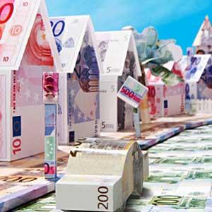 Las calles de una ciudad fabricadas con billetes de euro en relación a las nuevas medidas de la reforma concursal