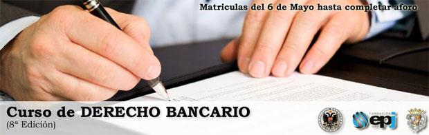 Imagen del 8º curso de derecho bancario que se celebra en Granada en la que aparecen las manos de un hombre firmando un documento