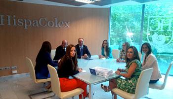 Abogados de HispaColex Jaén en una reunión en el bufete